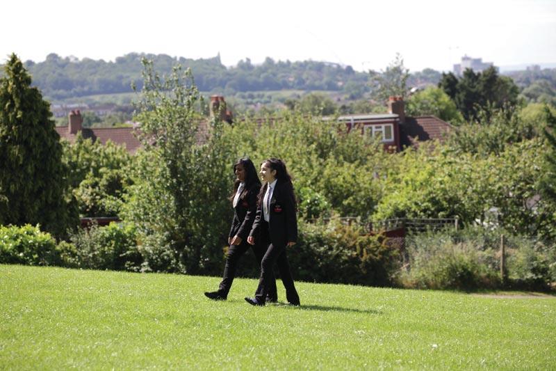 Girls-walking-in-field
